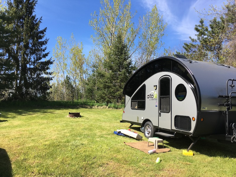 Alto 1713 Trailer set up on grass covered campsite at McRae Point Provincial Park