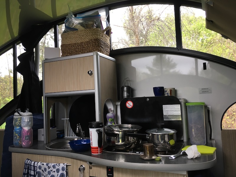 Springtime glamping showing interior of Alto 1713 trailer with stove and makings for tea and hot chocolate