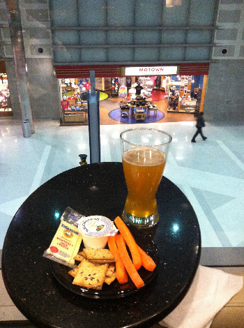 Settled in and enjoying the view of shoppers from our chairs with arm tables.