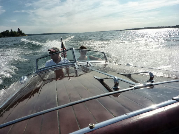 Riding in a vintage speedboat!