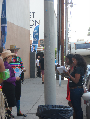 The 'clip board' girls interviewing for potential contestants in line at Let's Make A Deal.