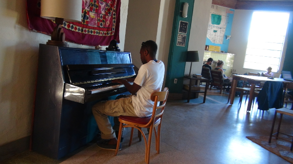 Playing the piano in the Freehand Miami lobby.
