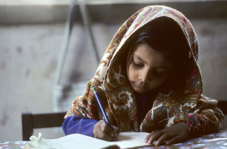 Photo by John Isacc of a school girl in Pakistan, care of the United Nations.