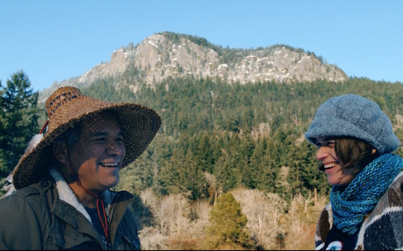 Hwiemtun and Erica Hargreave with Mount Maxwell in the background on SaltSpring Island