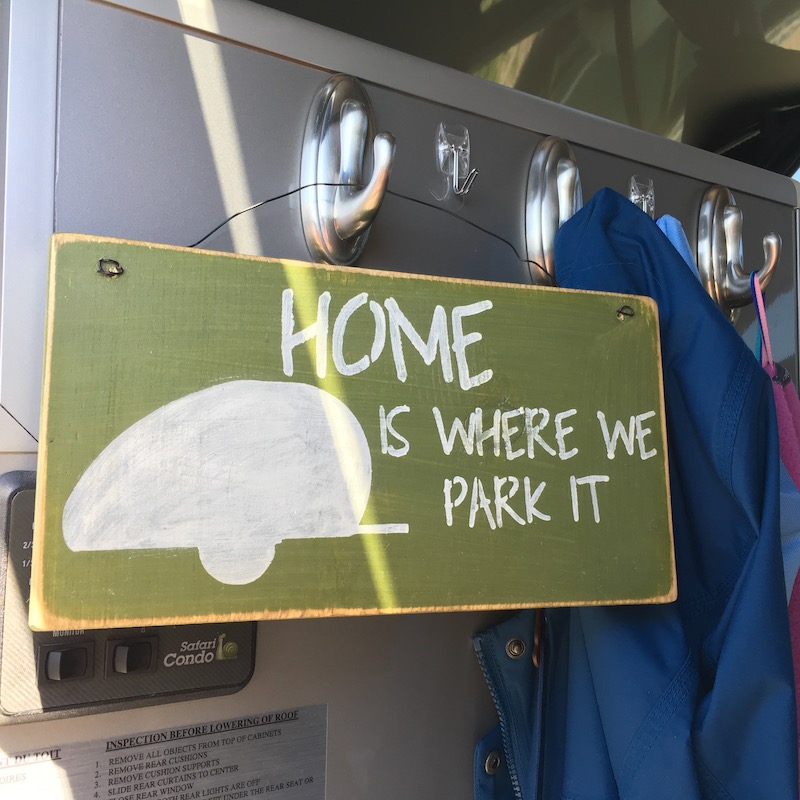 Home is where we park it sign hung up inside door of Alto 1713 trailer