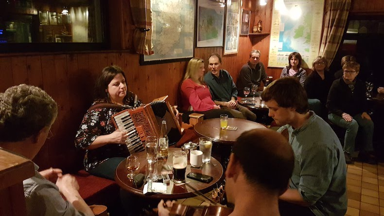 Musicians playing Irish tunes in the bar at the Doonmoor Hotel on Inishbofin Island.